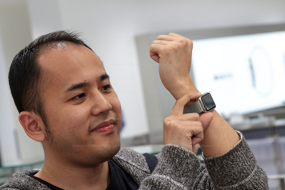 Yoichiro Masui (39) poses with his newly bought Apple watch on its officail release at the Softbank Store in Omotesando, He was the first customer to buy the watch. Tokyo, Japan. Friday April 24th 2015. Apple's long anticipated  smart watch was officially put on sale in stores in just nine countries. Japan and Australia which are furthest east were the first places in the world where this watch was available for purchase.