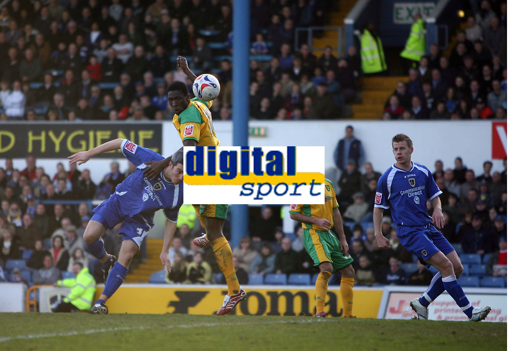 Photo: Rich Eaton.<br /> <br /> Cardiff City v Norwich City. Coca Cola Championship. 10/03/2007. Dickson Etuhu of Norwich jumps higher than Kevin McNaughton of Cardiff