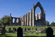 Wide landscape of the 12th-century ruins Augustinian monastery—now generally known as Bolton Priory. It sits within the landscape of the Yorkshire Dales, adjacent to the village of Bolton Abbey.
