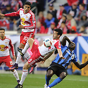 HARRISON, NEW JERSEY- November 06:  Gonzalo Veron #30 of New York Red Bulls, Felipe Martins #8 of New York Red Bulls and Hassoun Camara #6 of Montreal Impact challenge for the ball during the New York Red Bulls Vs Montreal Impact MLS playoff match at Red Bull Arena, Harrison, New Jersey on November 06, 2016 in Harrison, New Jersey. (Photo by Tim Clayton/Corbis via Getty Images)