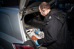 © Licensed to London News Pictures. 22/12/2018. Crawley, UK. Police search a vehicle  outside a property in Crawley. Is is not clear if this is in connection with the couple detained by police over the Gatwick drone attacks. Photo credit: Peter Macdiarmid/LNP