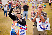 12 JUNE 2010 - PHOENIX, AZ: A married couple cheers in support of Arizona SB 1070 at a rally in Phoenix Saturday. About 500 people, many from California and Florida, came to Bolin Memorial Park in Phoenix Saturday. The pro SB 1070 rally was sponsored by Tea Party.   PHOTO BY JACK KURTZ