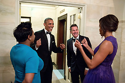 President Barack Obama and First Lady Michelle Obama celebrate with outgoing Social Secretary Jeremy Bernard and incoming Social Secretary Deesha Dyer in the Ground Floor Corridor following the State Dinner at the White House, April 28, 2015. (Official White House Photo by Pete Souza)<br /> <br /> This official White House photograph is being made available only for publication by news organizations and/or for personal use printing by the subject(s) of the photograph. The photograph may not be manipulated in any way and may not be used in commercial or political materials, advertisements, emails, products, promotions that in any way suggests approval or endorsement of the President, the First Family, or the White House.
