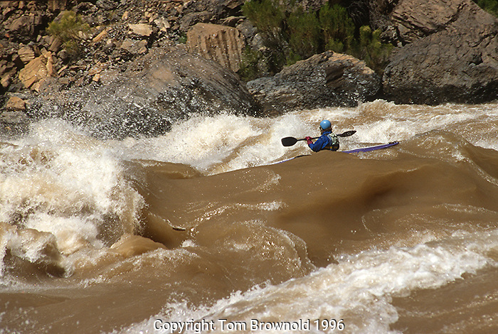 A kayaker entering Lava Falls rapid during a high water (flooding) event. The river is flowing at 45000cfs for a sediment transportation/beach building experiment.