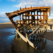 In 1906, the crew of the sailing ship Peter Iredale took refuge at Fort Stevens, after she ran aground on Clatsop Spit. The wreck is visible today, within Fort Stevens State Park, along the Oregon Coast, USA. Active from 1863–1947, Fort Stevens was an American military installation that guarded the mouth of the Columbia River in the state of Oregon. Built near the end of the American Civil War, it was named for a slain Civil War general and former Washington Territory governor, Isaac I. Stevens. Multiple overlapping photos were stitched to make this panorama.