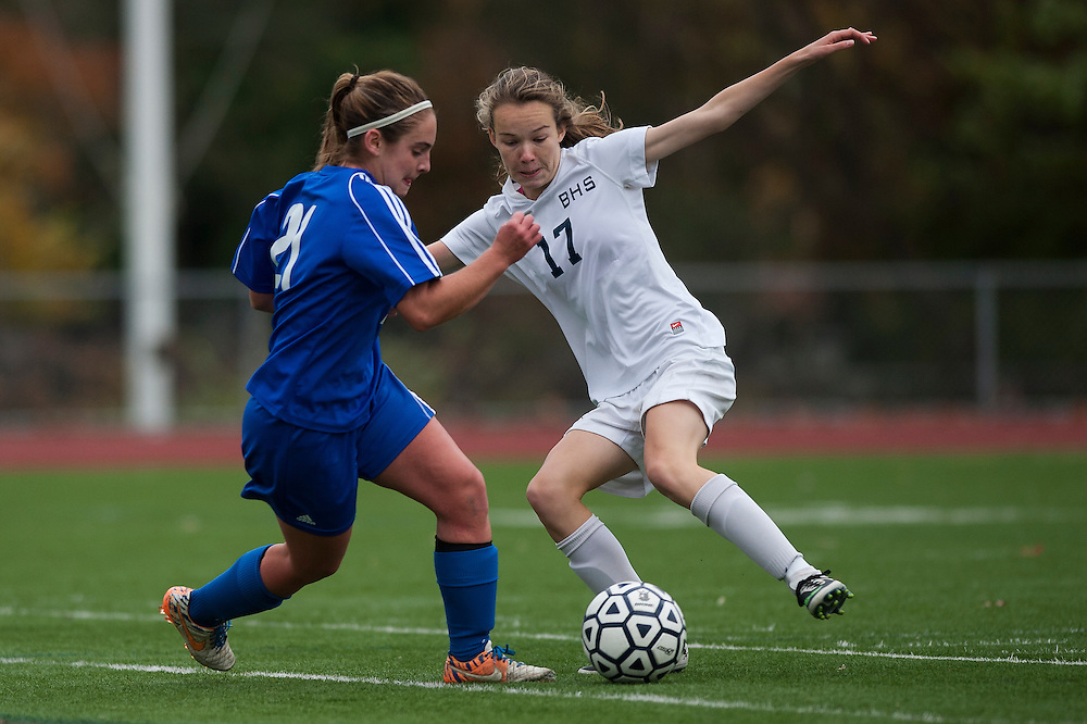 Burlington's Pascal Gulick (21) and U-32's Maggie Kirby (21) battle for the ball during the girls playoff soccer game between the U-32 Raiders and the Burlington Sea Horses at Buck Hard Field on Friday afternoon October 24, 2014 in Burlington, Vermont (BRIAN JENKINS, for the Free Press)