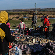 KARAKASIM, TURKEY - MARCH 2: A group of Afghan refugees prepare to make camp near the Turkish-Greek border outside of Karakasim, Turkey on Monday, March 2, 2020. Turkey said it would no longer stop refugees from reaching Europe days after the country suffered heavy losses during an attack in Syria. Byron Smith for Le Monde