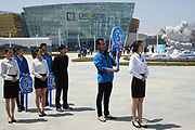 Staff awaiting guests arriving at Rizhao Ocean Park, Marina, opening ceremonies, Shandong Province