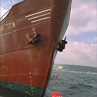 In Greenpeace's first action against an Israeli polluter activists from the MV Greenpeace prevented the Israeli vessel ARIBEL from sailing into the int. waters of the Mediterranean Sea to dump toxic sludge by jumping into the waters and forming a human barrier. GP demanded that the ARIBEL return the toxic sludge, containing a cocktail of toxics including arsenic, cadmium, copper & zinc, to sender, factories along the Kishon River. Haifa, Israel. Accession #: 2.95.135.002.14