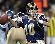St. Louis Rams quarterback Marc Bulger gets ready to fire the ball down field against the Seattle Seahawks in the first half of the Rams 23-12 win in St. Louis, Missouri, November 14, 2004.