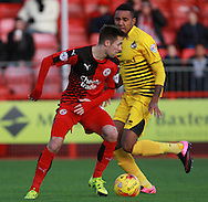 Crawley Town midfielder Gwion Edwards shields the ball from Bristol Rovers midfielder Christian Montano during the Sky Bet League 2 match between Crawley Town and Bristol Rovers at the Checkatrade.com Stadium, Crawley, England on 21 November 2015. Photo by Bennett Dean.