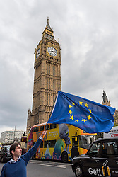© Licensed to London News Pictures. 13/10/2016. London, UK. Phil Jones, 34, from High Wycombe, waves the European flag outside the Houses of Parliament.  As a member of the People's Challenge grassroots campaign, a member of the European Movement as well as a Conservative party member, Mr Jones is supporting the legal challenge to force the government to seek Parliamentary approval before Brexit negotiations begin. Photo credit : Stephen Chung/LNP