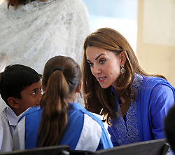 The Duke and Duchess of Cambridge during a visit to a school in central Islamabad on day two of the royal visit to Pakistan.