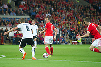 Football - 2017 / 2018 _Wales v Austria_FIFA World Cup Qualifier 2018<br /> <br /> Gareth Bale of Wales flicks the ball on to create a chance for Ben Davies of Wales--- at Cardiff City Stadium.<br /> <br /> COLORSPORT/WINSTON BYNORTH