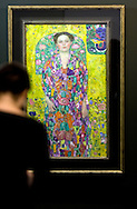 A visitor getting a preview of Portrait of Eugenia Primavesi (1913-14), part of Gustav Klimt: Painting, Design and Modern Life in Vienna 1900 at the Tate Liverpool which opens on 30th May, 2008. The gallery is hosting the first-ever UK exhibition by Austrian artist Klimt (1862-1918) as part of Liverpool's reign as 2008 European Capital of Culture. The show includes a full-scale reconstruction of the The Beethoven Frieze (1901-2) in addition to numerous paintings, drawings and furniture designs and runs until 31st August, 2008.