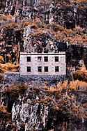 Abandoned building on a rocky hillside