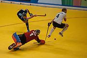Reading's Richard Mantell beats Richard Potton in the East Grinstead goal as Glen Kirkham taking avoiding action. East Grinstead v Reading, Hockey 5s, SSE Arena, Wembley, London, UK on 25 January 2015. Photo: Simon Parker