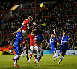Aden Flint of Bristol City heads a shot as John Egan of Gillingham challenges - Photo mandatory by-line: Rogan Thomson/JMP - 07966 386802 - 29/01/2015 - SPORT - FOOTBALL - Bristol, England - Ashton Gate Stadium - Bristol City v Gillingham - Johnstone's Paint Trophy Southern Area Final Second Leg.