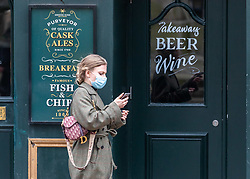 © Licensed to London News Pictures. 17/02/2021. London, UK. Members of the public walk past a pub in Westminster, London as Downing Street mulls over how and when to unlock the country from coronavirus restrictions. Today, Prime Minister Boris Johnson revealed that the relaxation of restrictions would be done in stages and would focus on the data not on dates for the easing of lockdown with pubs being the last to reopen. Photo credit: Alex Lentati/LNP