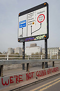 The London skyline beyond graffiti on Waterloo Bridge on day 4 of protests by climate change environmental activists with pressure group Extinction Rebellion, on18th April 2019, in London, England.