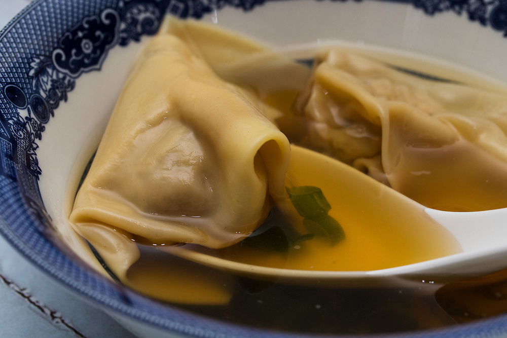 Pork Broth Soup with Wontons in a Blue Bowl