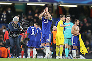 John Terry, the Chelsea captain applauds the Chelsea fans after the final whistle.UEFA Champions league group G match, Chelsea v Porto at Stamford Bridge in London on Wednesday 9th December 2015.<br /> pic by John Patrick Fletcher, Andrew Orchard sports photography.