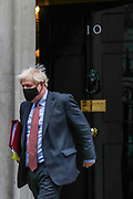 Britain's Prime Minister Boris Johnson wearing face mask waves to the media as he leaves 10 Downing Street heading to the House of Commons for his weekly Prime Minister's Questions in London, Wednesday, Sept 30, 2020. On Wednesday MPs will be asked to renew emergency powers, originally passed in March, to tackle the pandemic. (VXP Photo/ Vudi Xhymshiti)