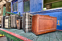 Old luggage over a cart in an old train station over a cart in an old train station over a cart in an old train station