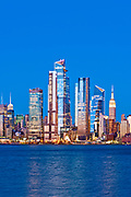 New York skyline at night featuring the skyscrapers of Hudson Yards, the West Side of Manhattan and the Hudson River, New York City.