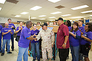 FedEx employee Cal Robinson (far left) presents a playhouse to Tito A. Cortez (United States Army, Vietnam) (right) and Fernando Casanova (United States Army, Iraq) (center) of the Veterans Supportive Services Agency, Inc. at the Habitat For Humanity in Milpitas, Calif., on Sept. 11, 2012.  Photo by Stan Olszewski/SOSKIphoto.