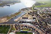 Nederland, Utrecht, Bunschoten-Spakenburg, 01-05-2013;<br /> Jachthaven met aangemeerde zeilboten, nieuwbouwwijk met huizen in oude stijl en links Sportpark de Westmaat,het voetbalveld en -stadion van de IJsselmeervogels aan de Westdijk.<br /> Marina with moored sailboats, new neighbourhood with old style houses and left sporting grounds  Westmaat, the football field and stadium of the local football club.<br /> luchtfoto (toeslag op standard tarieven)<br /> aerial photo (additional fee required)<br /> copyright foto/photo Siebe Swart