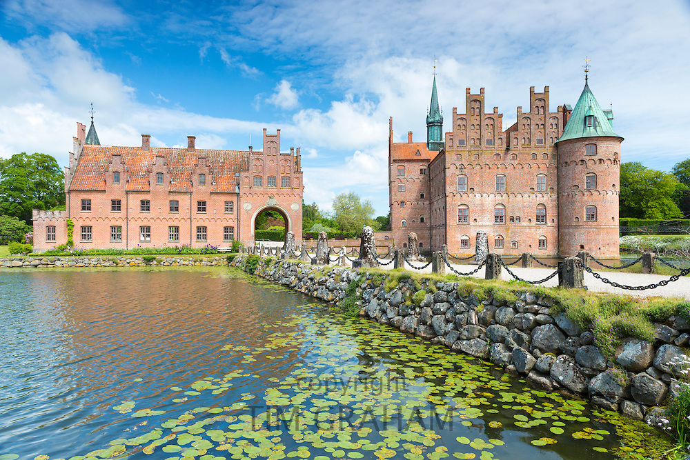 Egeskov Slot Castle, 16th Century Renaissance, with moat turrets, Titania's Palace, in south of island of Funen, Denmark