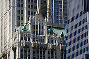 Modern architecture and the 1903 Gothic Woolworth building on the left, in Manhattan, New York City. High-rise buildings are mostly corporate offices though some apartments in this, one of the world's great megacities. They occupy addresses along Broadway - a mixture of modernity and 19th century architecture can be seen in detail. The Woolworth Building, at 233 Broadway, Manhattan, New York City, designed by architect Cass Gilbert and completed in 1913, is an early US skyscraper. The original site for the building was purchased by F. W. Woolworth and his real estate agent Edward J. Hogan by April 15, 1910, from the Trenor Luther Park Estate and other owners for $1.65 million.
