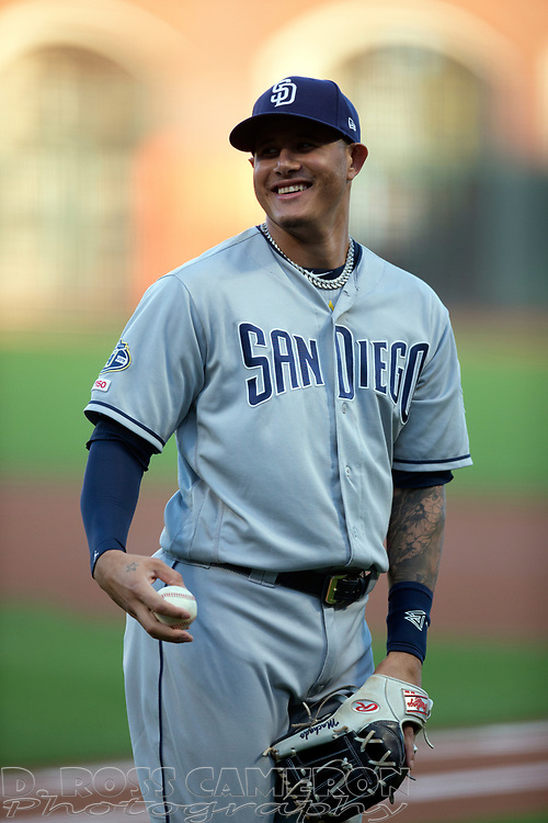 San Diego Padres third baseman Manny Machado smiles while warming up before a baseball game, Thursday, Aug. 29, 2019, in San Francisco. (AP Photo/D. Ross Cameron)