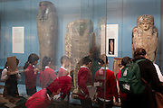 Schoolchildren work on projects about Eyptian Mummies in the British Museum, on 28th February 2017, in London, England.