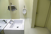 male toilet room inside CaixaForum Madrid Architects Herzog and de Meuron