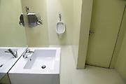 male toilet room inside CaixaForum Madrid Architects Herzog and de Meuron
