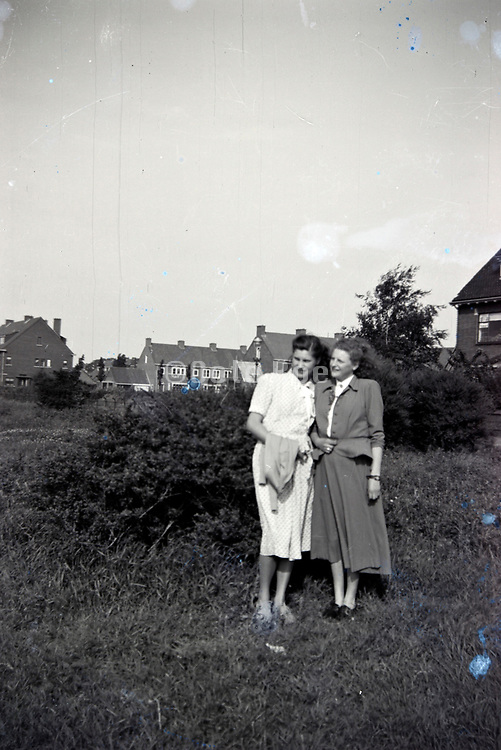 friends standing in the field at the edge of a new housing development Netherlands 1950s