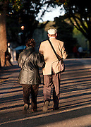 Elderly couple walking in the park at Villa Borghese, Rome, Italy.