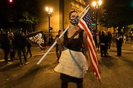 Quaker Helen Cullen protesting the presence of Federal Militia in downtown Portland, Oregon cullenraphael@gmail.com