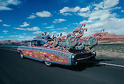 California artist Larry Fuente, called the Leonardo De Vinci of the art car movement by the NY Times drives his Mad Cad through the SW US.  The car with over a million beads, baubles and bangles took four years to build.