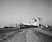 "Ackroyd 02766-02. ""Dock Commission. S. S. Yamadono Maru & Union Pacific diesel #1087 near Quaker Oats Co. Dock. April 2, 1951"""
