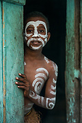 Local children body painted<br /> Arborek Island<br /> Raja Ampat<br /> Coral triangle<br /> Indonesia