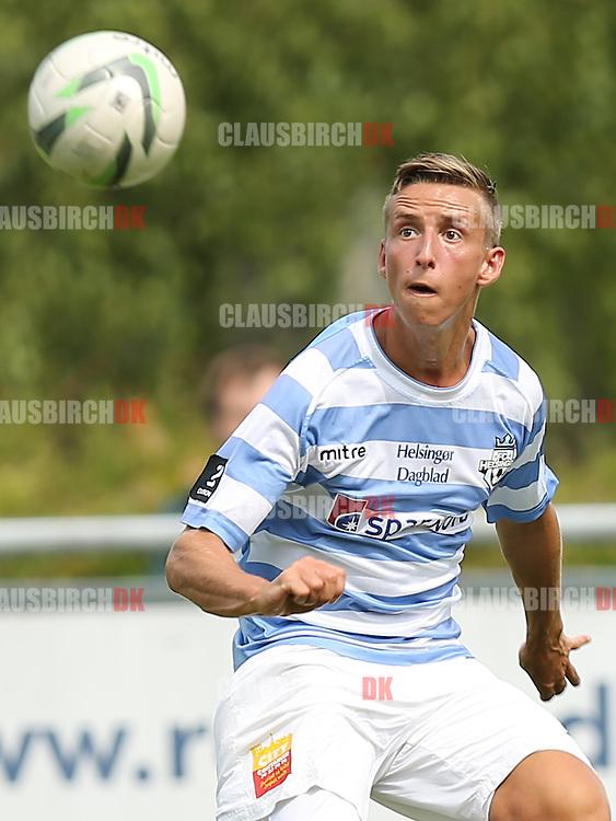 FODBOLD: Alexander Augustesen (FC Helsingør) har øje på bolden under kampen i 2. Division Øst mellem FC Helsingør og Avarta den 10. august 2014 på Helsingør Stadion. Foto: Claus Birch