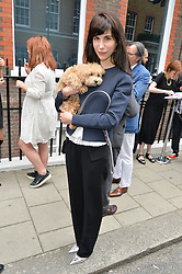 CAROLINE VON WESTENHOLZ and her dog Swifty at the launch of the new collection from Limoland held at Anderson & Sheppard's Haberdashery, 17 Clifford Street,London on 16th June 2014.