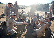 Sgt. Thomas Fowlkes goes over the battle plan with his assault-men while waiting for the start of the days' live-fire exercises for the 2nd Battalion, 5th Marine Regiment at Camp Pendleton..