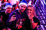 Sky Sports Presenter Laura Woods takes a selfie with a fan during the PDC World Championship darts at Alexandra Palace, London, United Kingdom on 14 December 2018.