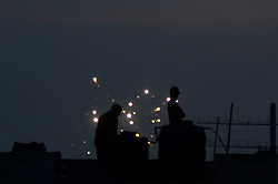 June 25, 2017 - Allahabad, India - Indian muslims stand on roof top of a building to sight moon ,near decorated  jama Masjid , on the eve of Eid al-Fitr festival , in Allahabad on June 25,2017. (Credit Image: © Ritesh Shukla/NurPhoto via ZUMA Press)