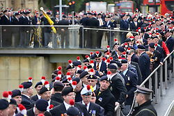 © Licensed to London News Pictures. 18/10/2012. Westminster, UK Members queue to enter Parliament. Members past and present from the 2nd Battalion of The Royal Regiment of Fusiliers march on Parliament today 18 October 2012 to hear a debate in the House on the future of their regiment. The regiment's existence is threatened by the governments plans to reduce the armed forces by 20,000 personel. Photo credit : Stephen Simpson/LNP