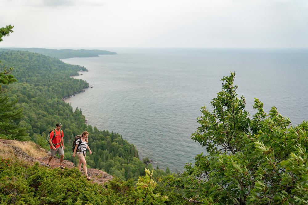 Hiking Bare Bluff on the Keweenaw Peninsula near Lac Labelle, Michigan.